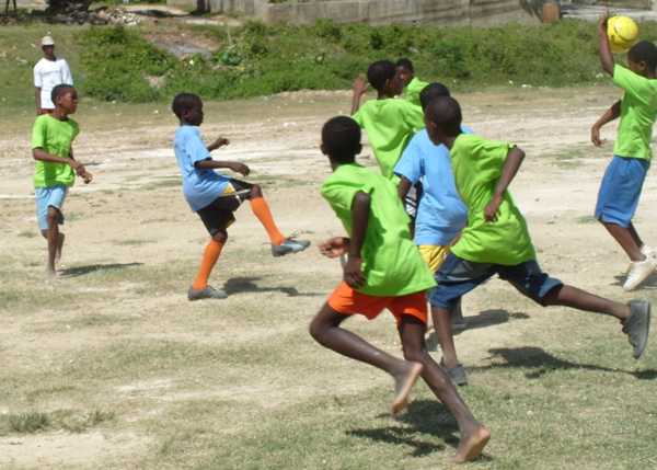 Provide Soccer Gears for Community Youths at Help To Impact Lives